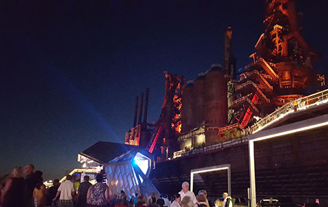 A concert is taking place at the Levitt Pavilion right in front of the Bethlehem Steel Blast Furnaces